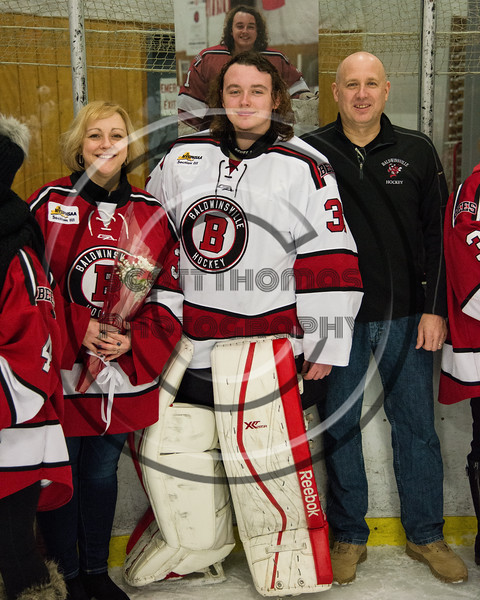 Baldwinsville Bees goalie Tommy Blais (31) and his family on Senior Night at the Lysander Ice Arena in Baldwinsville, New York on Tuesday, February 5, 2019.