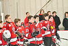 Baldwinsville Bees Brett Collier (21) standing for the National Anthem before playing the Liverpool Warriors in a NYSPHSAA Section III Boys Ice hockey game at Lysander Ice Arena in Baldwinsville, New York on Tuesday, December 10, 2019.