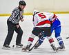 Baldwinsville Bees Alexander Pompo (5) faces off against  Whitesboro Warriors Noah Scranton (25) in NYSPHSAA Section III Boys Ice Hockey action at the Lysander Ice Arena in Baldwinsville, New York on Friday, December 13, 2019. Whitesboro won 3-1.
