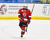 Baldwinsville Bees Garrett Sutton (22) being introduced before playing the Christian Brothers Academy in a NYSPHSAA Section III Boys Ice hockey game at Onondaga Nation Arena in Nedrow, New York on Tuesday, January 7, 2020.