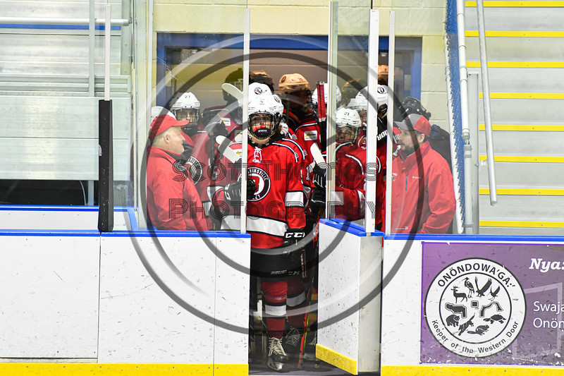 Baldwinsville Bees Alexander Pompo (5) waiting to take the ice before playing the Christian Brothers Academy in a NYSPHSAA Section III Boys Ice hockey game at Onondaga Nation Arena in Nedrow, New York on Tuesday, January 7, 2020.