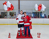 Baldwinsville Bees Christian Ficarra (17) honors Judy Tack on Teacher Appreciation Night at the Lysander Ice Arena in Baldwinsville, New York on Tuesday, January 14, 2020.