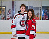 Baldwinsville Bees Brett Collier (21) honors Mrs. Hoellrich on Teacher Appreciation Night at the Lysander Ice Arena in Baldwinsville, New York on Tuesday, January 14, 2020.