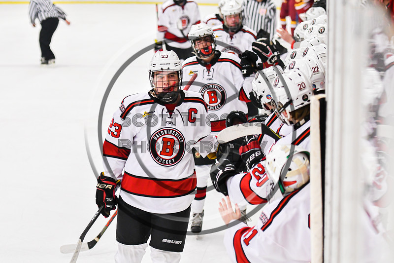 Baldwinsville Bees Braden Lynch (23) celebrates his goal against the Ithaca Little Red in NYSPHSAA Section III Boys Ice Hockey action at the Lysander Ice Arena in Baldwinsville, New York on Tuesday, January 14, 2020. Ithaca won 3-2.