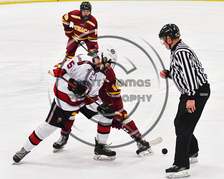 Baldwinsville Bees Alexander Pompo (5) wins a face-off against Ithaca Little Red Colden Goodrow (16) in NYSPHSAA Section III Boys Ice Hockey action at the Lysander Ice Arena in Baldwinsville, New York on Tuesday, January 14, 2020. Ithaca won 3-2.