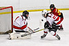 Baldwinsville Bees goalie Jon Schirmer (1) makes a save against the Ithaca Little Red in NYSPHSAA Section III Boys Ice Hockey action at the Lysander Ice Arena in Baldwinsville, New York on Tuesday, January 14, 2020. Ithaca won 3-2.