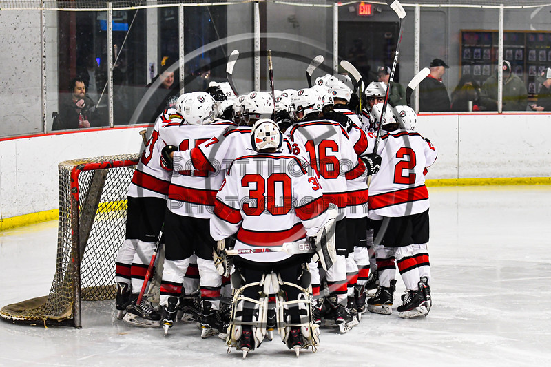 Baldwinsville Bees huddle up before the start of the Third Period against the Ithaca Little Red in NYSPHSAA Section III Boys Ice Hockey action at the Lysander Ice Arena in Baldwinsville, New York on Tuesday, January 14, 2020. Ithaca won 3-2.