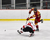 Ithaca Little Red Thomas Kopelson (15) fires the puck past Baldwinsville Bees Cooper Foote (8) in NYSPHSAA Section III Boys Ice Hockey action at the Lysander Ice Arena in Baldwinsville, New York on Tuesday, January 14, 2020. Ithaca won 3-2.