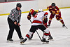 Baldwinsville Bees Alexander Pompo (5) facing off against Ithaca Little Red Colden Goodrow (16) in NYSPHSAA Section III Boys Ice Hockey action at the Lysander Ice Arena in Baldwinsville, New York on Tuesday, January 14, 2020. Ithaca won 3-2.
