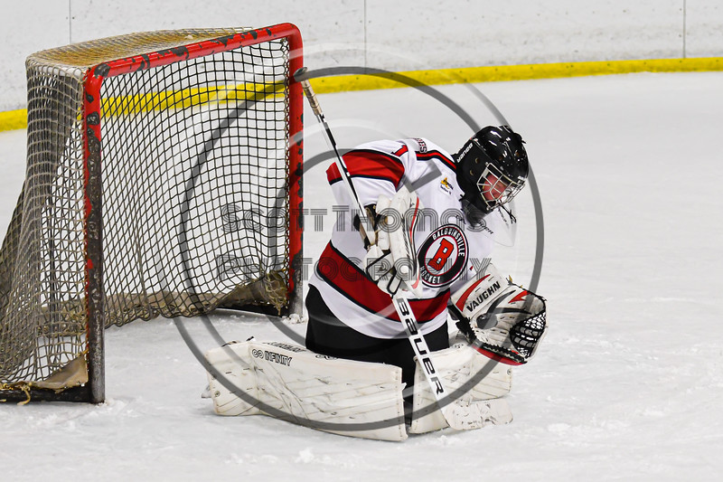 Baldwinsville Bees goalie Jon Schirmer (1) makes a glove save against the Ithaca Little Red in NYSPHSAA Section III Boys Ice Hockey action at the Lysander Ice Arena in Baldwinsville, New York on Tuesday, January 14, 2020. Ithaca won 3-2.