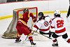 Ithaca Little Red Colden Goodrow (16, not pictured) sores a goal against Baldwinsville Bees goalie Jon Schirmer (1) in NYSPHSAA Section III Boys Ice Hockey action at the Lysander Ice Arena in Baldwinsville, New York on Tuesday, January 14, 2020. Ithaca won 3-2.