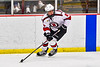 Baldwinsville Bees Cooper Foote (8) with the puck looking to make a play against the Ithaca Little Red in NYSPHSAA Section III Boys Ice Hockey action at the Lysander Ice Arena in Baldwinsville, New York on Tuesday, January 14, 2020. Ithaca won 3-2.