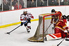 Baldwinsville Bees Matt Speelman (18) with the puck behind the Ithaca Little Red net in NYSPHSAA Section III Boys Ice Hockey action at the Lysander Ice Arena in Baldwinsville, New York on Tuesday, January 14, 2020. Ithaca won 3-2.
