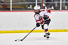 Baldwinsville Bees Cooper Foote (8) with the puck against the Ithaca Little Red in NYSPHSAA Section III Boys Ice Hockey action at the Lysander Ice Arena in Baldwinsville, New York on Tuesday, January 14, 2020. Ithaca won 3-2.