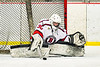Baldwinsville Bees goalie Brad O'Neil (30) makes a save against the Cicero-North Syracuse Northstars in NYSPHSAA Section III Boys Ice Hockey action at the Lysander Ice Arena in Baldwinsville, New York on Tuesday, January 21, 2020. Baldwinsville won 7-0.