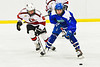 Baldwinsville Bees Cooper Foote (8) checking Cicero-North Syracuse Northstars Braylen Tuff (27) in NYSPHSAA Section III Boys Ice Hockey action at the Lysander Ice Arena in Baldwinsville, New York on Tuesday, January 21, 2020. Baldwinsville won 7-0.