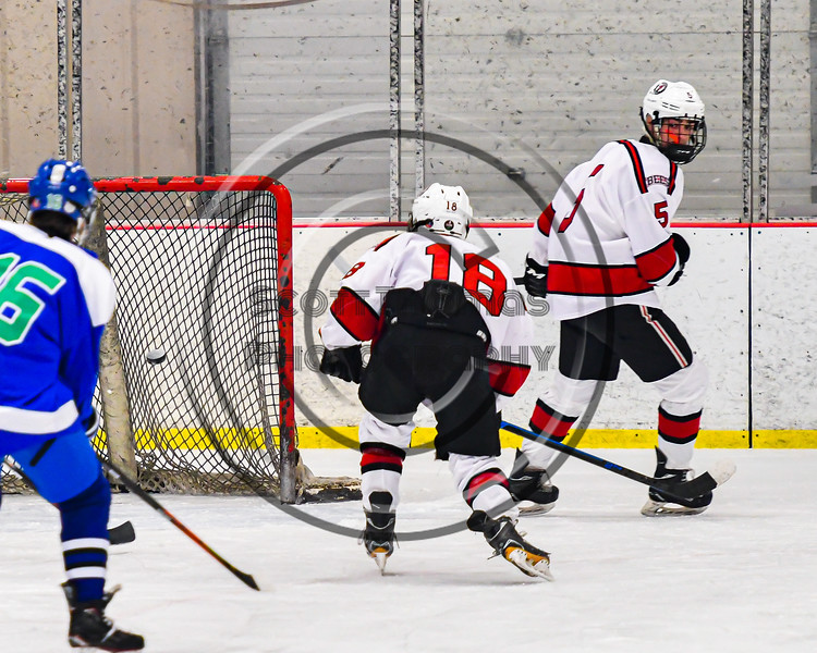 Baldwinsville Bees Matt Speelman (18) shoots and scores against the Cicero-North Syracuse Northstars in NYSPHSAA Section III Boys Ice Hockey action at the Lysander Ice Arena in Baldwinsville, New York on Tuesday, January 21, 2020. Baldwinsville won 7-0.