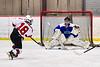 Baldwinsville Bees Matt Speelman (18) fires the puck at Cicero-North Syracuse Northstars goalie Jordan Miller (1) in NYSPHSAA Section III Boys Ice Hockey action at the Lysander Ice Arena in Baldwinsville, New York on Tuesday, January 21, 2020. Baldwinsville won 7-0.