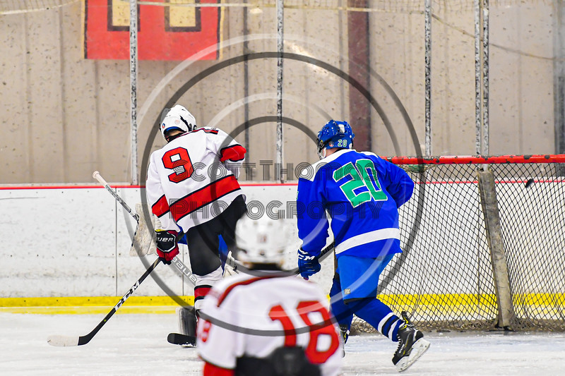 Baldwinsville Bees Matt Carner (9) tips the puck past Cicero-North Syracuse Northstars goalie Jordan Miller (2) for a goal in NYSPHSAA Section III Boys Ice Hockey action at the Lysander Ice Arena in Baldwinsville, New York on Tuesday, January 21, 2020. Baldwinsville won 7-0.