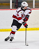 Baldwinsville Bees Garrett Sutton (22) with the puck against the Cicero-North Syracuse Northstars in NYSPHSAA Section III Boys Ice Hockey action at the Lysander Ice Arena in Baldwinsville, New York on Tuesday, January 21, 2020. Baldwinsville won 7-0.