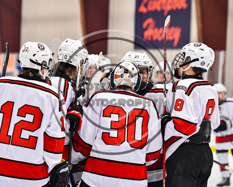 Baldwinsville Bees players congratulate goalie Brad O'Neil (30) on his shutout of the the Cicero-North Syracuse Northstars in a NYSPHSAA Section III Boys Ice Hockey game at the Lysander Ice Arena in Baldwinsville, New York on Tuesday, January 21, 2020. Baldwinsville won 7-0.