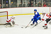 Baldwinsville Bees goalie Brad O'Neil (30) and Casey Scott (20) check the puck away from Cicero-North Syracuse Northstars Tyler Murray (15) in NYSPHSAA Section III Boys Ice Hockey action at the Lysander Ice Arena in Baldwinsville, New York on Tuesday, January 21, 2020. Baldwinsville won 7-0.