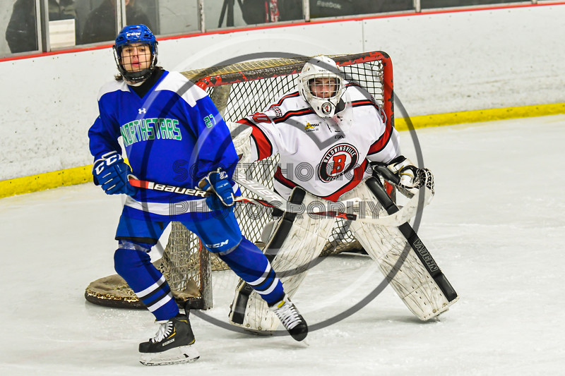 Baldwinsville Bees goalie Brad O'Neil (30) pushing Cicero-North Syracuse Northstars Braylen Tuff (27) out of his line of vision in NYSPHSAA Section III Boys Ice Hockey action at the Lysander Ice Arena in Baldwinsville, New York on Tuesday, January 21, 2020. Baldwinsville won 7-0.