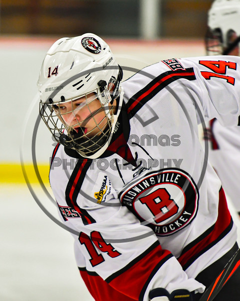 Baldwinsville Bees Reese Gilmore (14) warming up before playing the Cicero-North Syracuse Northstars in a NYSPHSAA Section III Boys Ice Hockey game at the Lysander Ice Arena in Baldwinsville, New York on Tuesday, January 21, 2020.