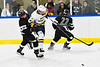 West Genesee Wildcats Billy Fisher (8) jumps past Syracuse Cougars Cameron Walsh (19) in a NYSPHSAA Section III Boys Ice hockey game at Shove Park in Camillus, New York on Wednesday, January 22, 2020. Game ended in a 1-1 tie.