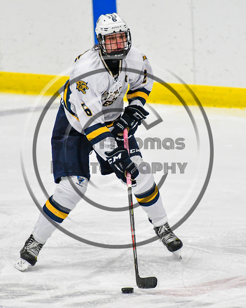 West Genesee Wildcats Nelson Jones (6) with the puck against the Syracuse Cougars in a NYSPHSAA Section III Boys Ice hockey game at Shove Park in Camillus, New York on Wednesday, January 22, 2020. Game ended in a 1-1 tie.
