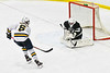 Syracuse Cougars goalie Evan Carter (28) makes a save against West Genesee Wildcats Jacob Kopek (6) in overtime of a NYSPHSAA Section III Boys Ice hockey game at Shove Park in Camillus, New York on Wednesday, January 22, 2020. Game ended in a 1-1 tie.