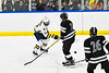 Syracuse Cougars Ethan Petty (22) blocks a shot by  West Genesee Wildcats Andrew Schneid (11) in a NYSPHSAA Section III Boys Ice hockey game at Shove Park in Camillus, New York on Wednesday, January 22, 2020. Game ended in a 1-1 tie.