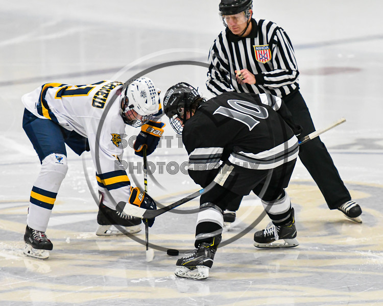 Syracuse Cougars Ryan Durand (10) facing off against West Genesee Wildcats Andrew Schneid (11) to start the Third Period of a NYSPHSAA Section III Boys Ice hockey game at Shove Park in Camillus, New York on Wednesday, January 22, 2020. Game ended in a 1-1 tie.