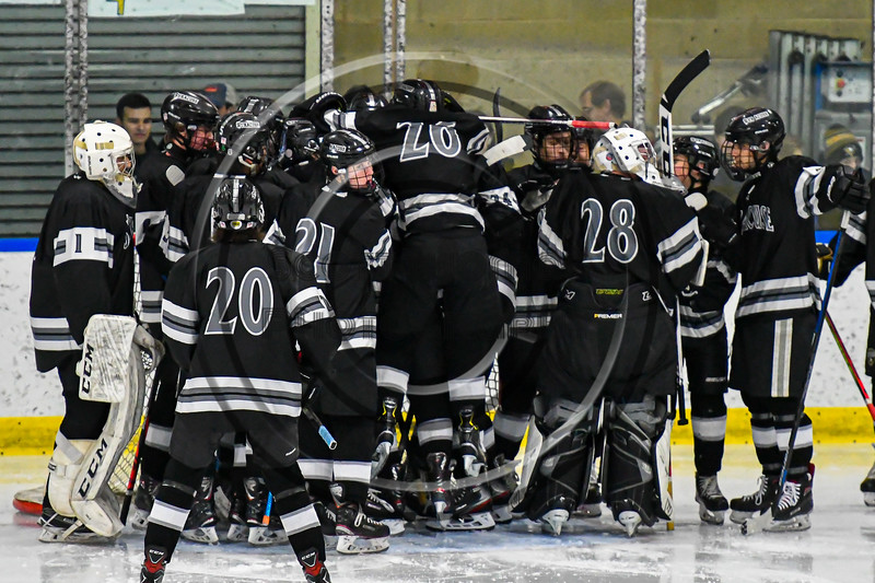 Syracuse Cougars huddle up before the Second Period against the West Genesee Wildcats in a NYSPHSAA Section III Boys Ice hockey game at Shove Park in Camillus, New York on Wednesday, January 22, 2020. Game ended in a 1-1 tie.