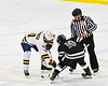 Syracuse Cougars Ryan Durand (10) facing off against West Genesee Wildcats Andrew Schneid (11) to start overtime in a NYSPHSAA Section III Boys Ice hockey game at Shove Park in Camillus, New York on Wednesday, January 22, 2020. Game ended in a 1-1 tie.