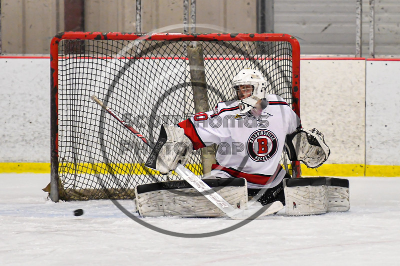 Baldwinsville Bees goalie Brad O'Neil (30) makes a save against the Rome Free Academy Black Knights in NYSPHSAA Section III Boys Ice Hockey action at the Lysander Ice Arena in Baldwinsville, New York on Tuesday, January 28, 2020. Game ended up in a tie, 1-1.