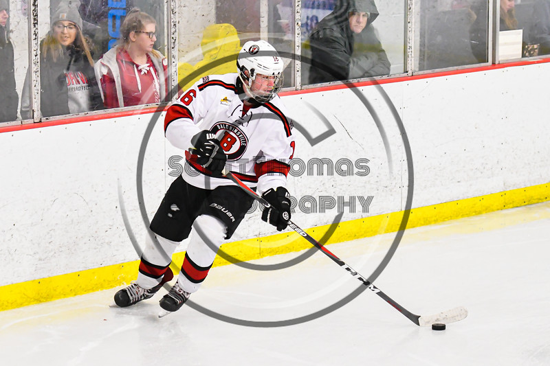 Baldwinsville Bees Luke Hoskin (16) with the puck against the Rome Free Academy Black Knights in NYSPHSAA Section III Boys Ice Hockey action at the Lysander Ice Arena in Baldwinsville, New York on Tuesday, January 28, 2020. Game ended up in a tie, 1-1.