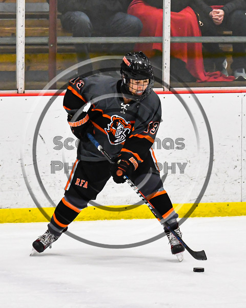 Rome Free Academy Black Knights Jared Hussein (13) with the puck against the Baldwinsville Bees in NYSPHSAA Section III Boys Ice Hockey action at the Lysander Ice Arena in Baldwinsville, New York on Tuesday, January 28, 2020. Game ended up in a tie, 1-1.
