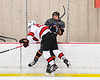 Baldwinsville Bees Braden Lynch (23) checks a Rome Free Academy Black Knights players in NYSPHSAA Section III Boys Ice Hockey action at the Lysander Ice Arena in Baldwinsville, New York on Tuesday, January 28, 2020. Game ended up in a tie, 1-1.