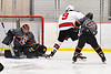 Baldwinsville Bees Matt Carner (9) is stopped by Rome Free Academy Black Knights goalie Isaiah Nebush (30 in NYSPHSAA Section III Boys Ice Hockey action at the Lysander Ice Arena in Baldwinsville, New York on Tuesday, January 28, 2020. Game ended up in a tie, 1-1.