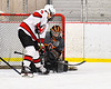 Baldwinsville Bees Matt Carner (9) tries to deflect the puck past Rome Free Academy Black Knights goalie Isaiah Nebush (30) in NYSPHSAA Section III Boys Ice Hockey action at the Lysander Ice Arena in Baldwinsville, New York on Tuesday, January 28, 2020. Game ended up in a tie, 1-1.