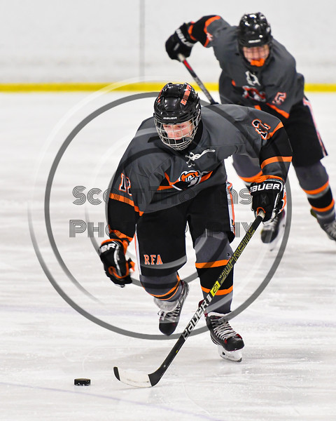 Rome Free Academy Black Knights Jake Premo (12) skating with the puck against the Baldwinsville Bees in NYSPHSAA Section III Boys Ice Hockey action at the Lysander Ice Arena in Baldwinsville, New York on Tuesday, January 28, 2020. Game ended up in a tie, 1-1.