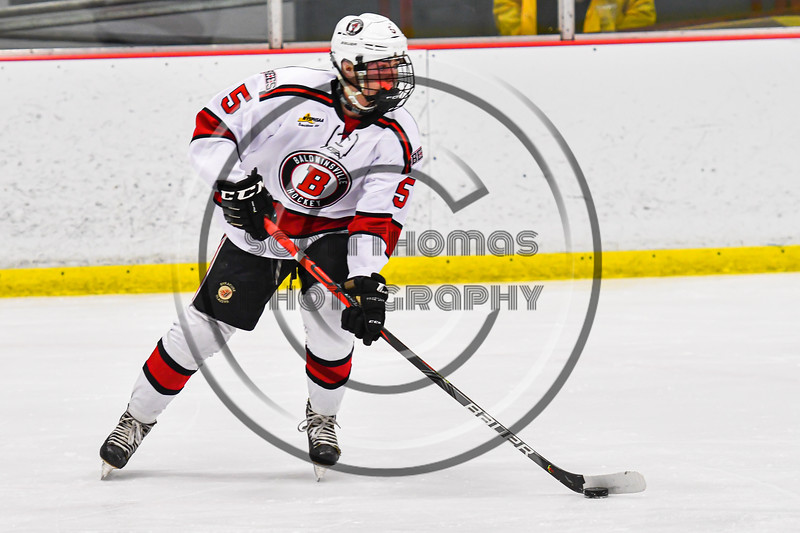 Baldwinsville Bees Alexander Pompo (5) with the puck against the Rome Free Academy Black Knights in NYSPHSAA Section III Boys Ice Hockey action at the Lysander Ice Arena in Baldwinsville, New York on Tuesday, January 28, 2020. Game ended up in a tie, 1-1.