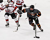 Rome Free Academy Black Knights Jake Hall (2) protecting the puck from Baldwinsville Bees Brett Collier (21) in NYSPHSAA Section III Boys Ice Hockey action at the Lysander Ice Arena in Baldwinsville, New York on Tuesday, January 28, 2020. Game ended up in a tie, 1-1.