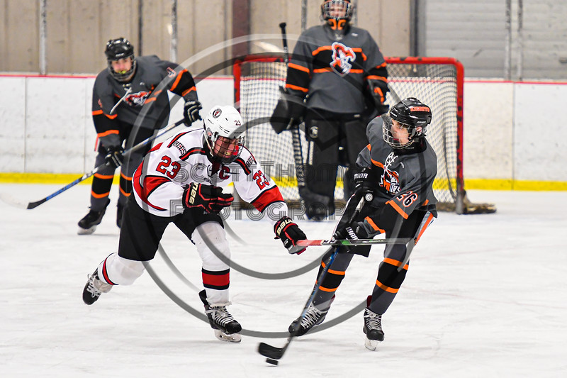 Baldwinsville Bees Braden Lynch (23) checks Rome Free Academy Black Knights Antonio Bevilacqua (26) in NYSPHSAA Section III Boys Ice Hockey action at the Lysander Ice Arena in Baldwinsville, New York on Tuesday, January 28, 2020. Game ended up in a tie, 1-1.