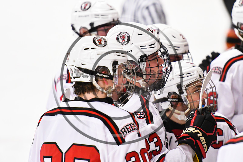 Baldwinsville Bees Braden Lynch (23) listening to his coaches before Overtime against the Rome Free Academy Black Knights in a NYSPHSAA Section III Boys Ice Hockey game at the Lysander Ice Arena in Baldwinsville, New York on Tuesday, January 28, 2020. Game ended up in a tie, 1-1.