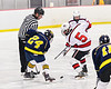 Baldwinsville Bees Alexander Pompo (5) faces off against Cazenovia Lakers Jack Donlin (24) in NYSPHSAA Section III Boys Ice Hockey action at the Lysander Ice Arena in Baldwinsville, New York on Friday, January 31, 2020. Baldwinsville won 8-1.