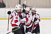 Baldwinsville Bees players celebrate the goal by Connor Santay (4) against the Cazenovia Lakers in NYSPHSAA Section III Boys Ice Hockey action at the Lysander Ice Arena in Baldwinsville, New York on Friday, January 31, 2020. Baldwinsville won 8-1.