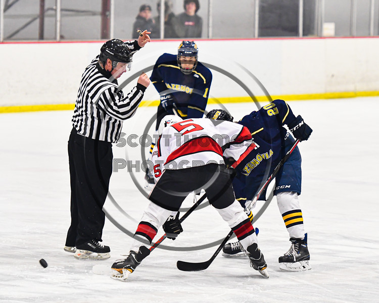 Baldwinsville Bees Alexander Pompo (5) faced off against Cazenovia Lakers Josh Whaley (2) to start a NYSPHSAA Section III Boys Ice Hockey game at the Lysander Ice Arena in Baldwinsville, New York on Friday, January 31, 2020. Baldwinsville won 8-1.