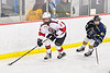 Baldwinsville Bees Cooper Foote (8) skating with the puck against Cazenovia Lakers James LaFever (27) in NYSPHSAA Section III Boys Ice Hockey action at the Lysander Ice Arena in Baldwinsville, New York on Friday, January 31, 2020. Baldwinsville won 8-1.